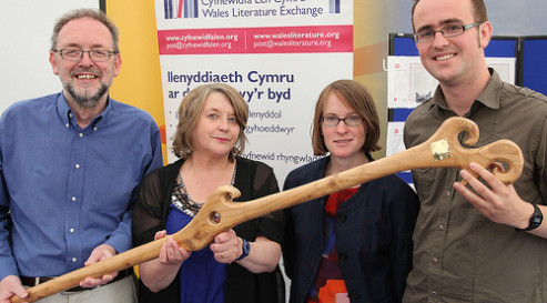 The organisers of the Translation Challenge are pictured with winner Hywel Griffiths being presented with a commissioned bardic staff at the 2013 National Eisteddfod of Wales.